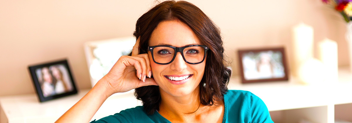 Smiling Brunette Woman in Glasses