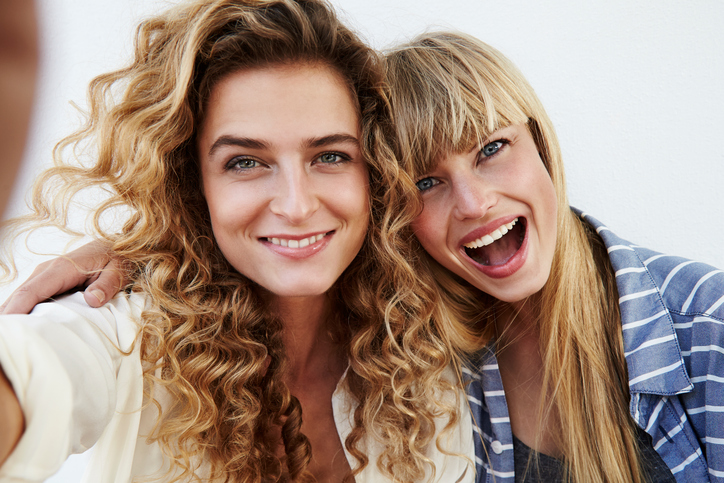 Two women smiling towards the camera
